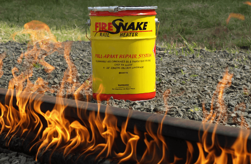 A FireSnake Rail Heater can along side a rail being heated for welding
