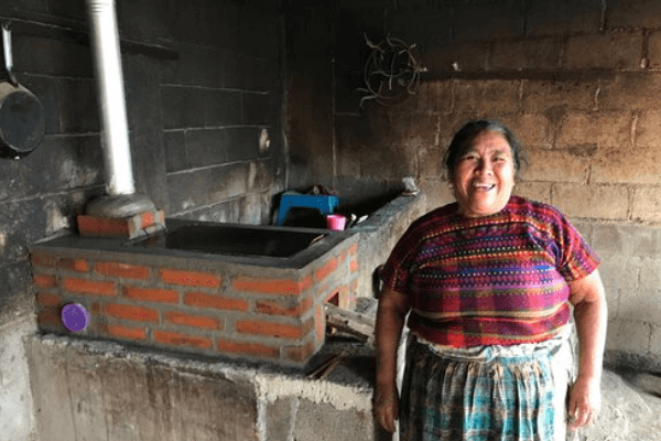 A Guatemalan woman with a Justa stove in place of an open fire